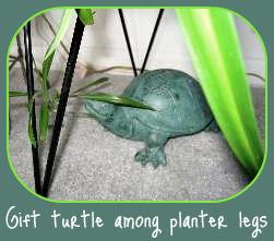Garden Animal Sculptures under planters